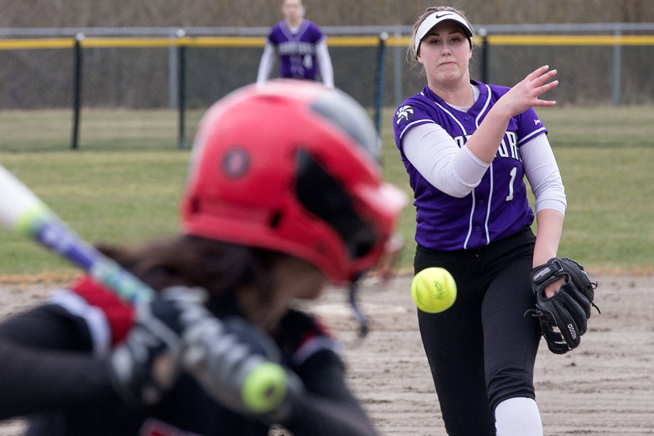 Edmonds-Woodway's Kyra Collingridge throws a pitch against Mountlake Terrace's Jenna Maxfield Wednesday afternoon at Mountlake Terrace High School on March 21, 2018. Edmonds-Woodway won 7-5. (Kevin Clark / The Daily Herald)