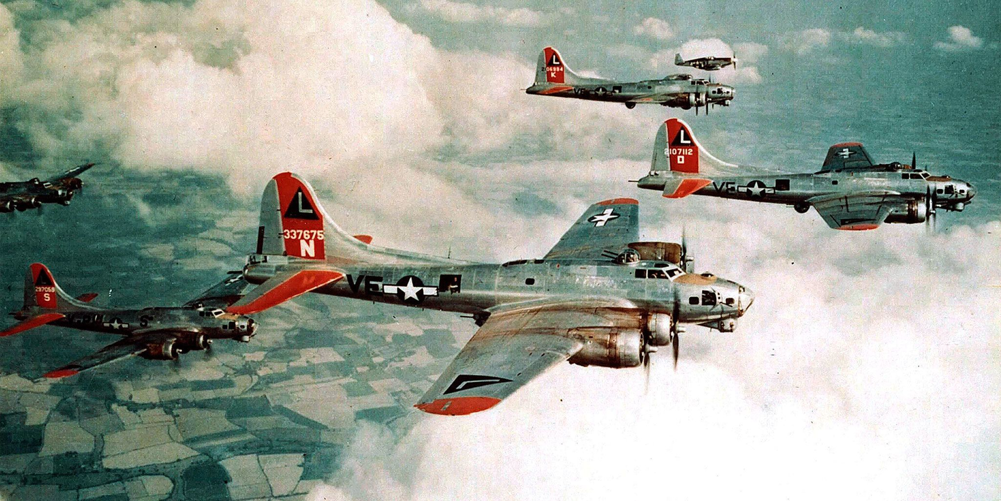 B-17G Fortresses of the 381st Bomb Group are escorted by a P-51B of the 354th Fighter Squadron in 1944. (National Archives and Records Administration)