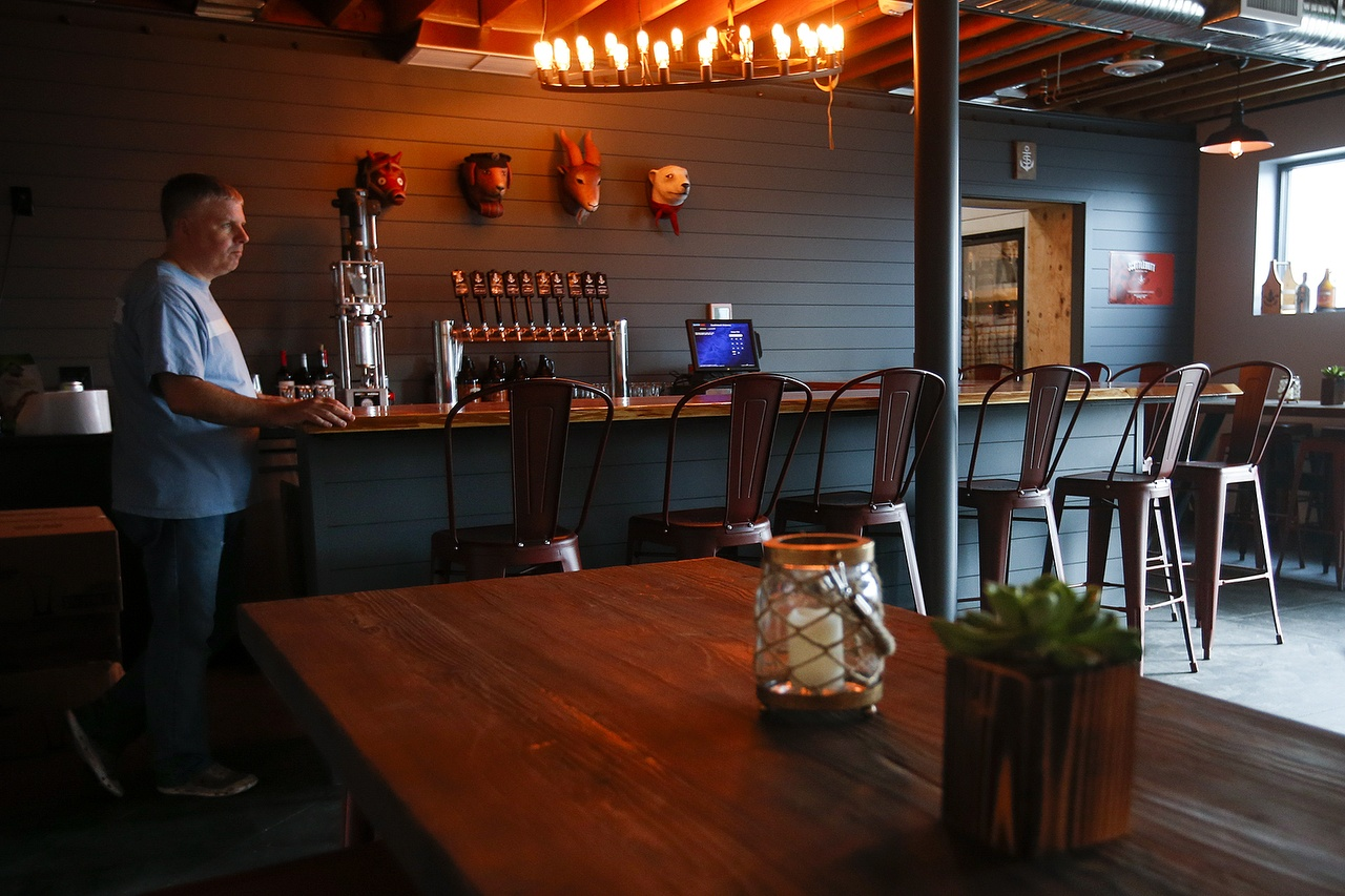Matt Stromberg, Head Brewer at Scuttlebutt Brewing, stands at the end of their new taproom's bar at the Cedar Street brewery location in Everett on Tuesday, Aug. 9, 2016. (Ian Terry / The Herald)