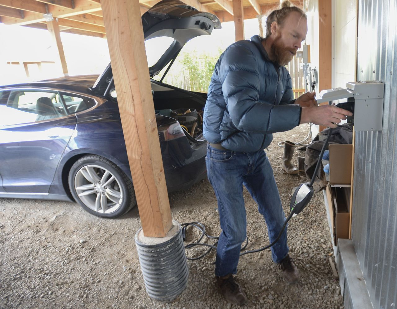 Ted Clifton plugs the charger for his Tesla into his solar-powered house in Bellingham on March 2.