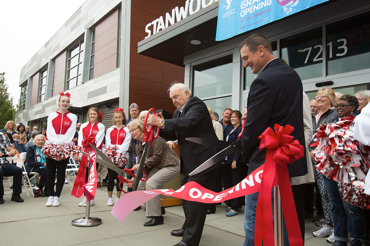 Floyd Jones (center) helps cut the ribbon at the Grand Opening on the Stanwood-Camano YMCA on Sept. 3 in Stanwood. Jones, a Seattle stockbroker and philanthropist with a home on Camano Island, donated $10 million through the Floyd & Delores Jones Foundation to the construction of the new YMCA. (Andy Bronson / The Herald)