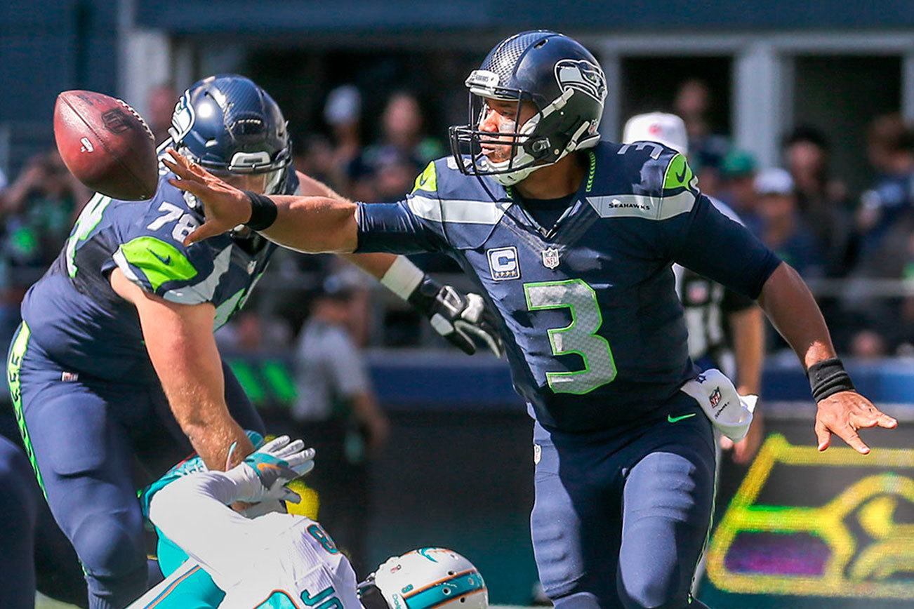 Wilson directs Seahawks' game-winning drive on a bad ankle