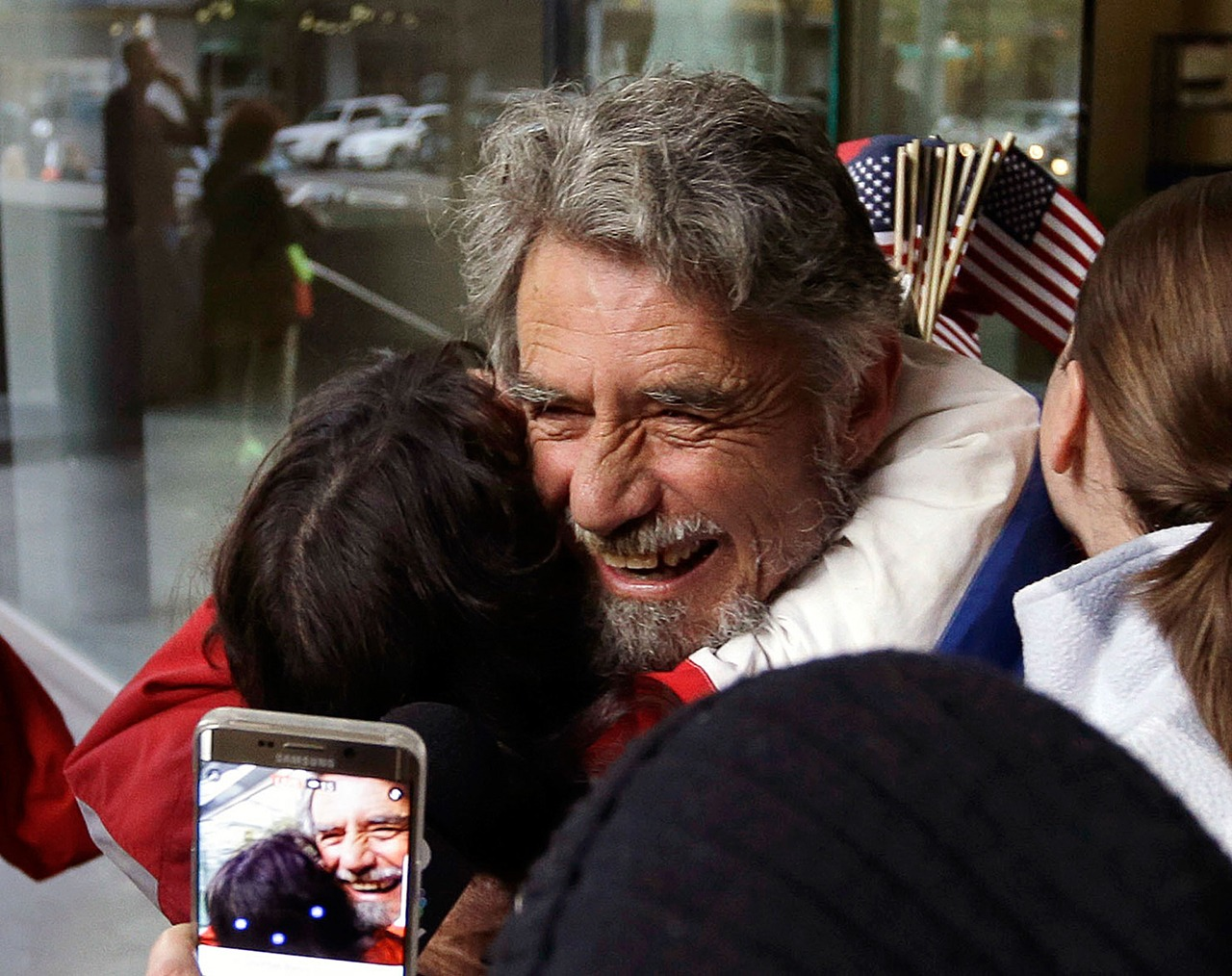 Defendant Neil Wampler is greeted by supporters as he leaves federal court in Portland, Oregon, on Thursday. (AP Photo/Don Ryan)
