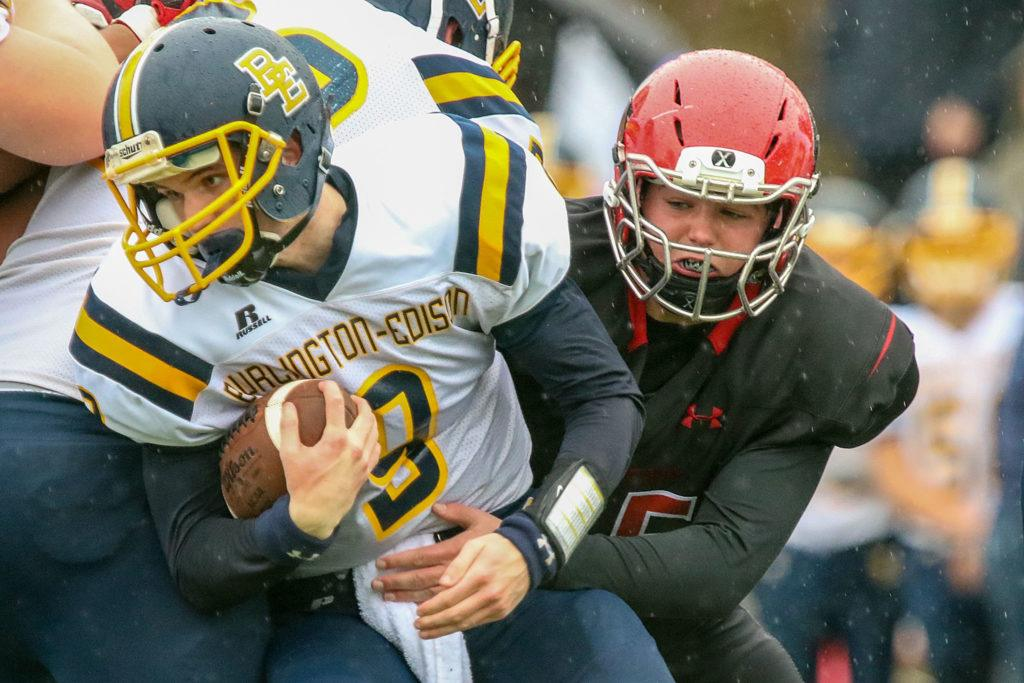 Burlington-Edison's Hunter Anderson is tackled by Archbishop Murphy's Luke Riojas Saturday afternoon at Terry Ennis Stadium on November 5, 2016. (Kevin Clark / The Herald)
