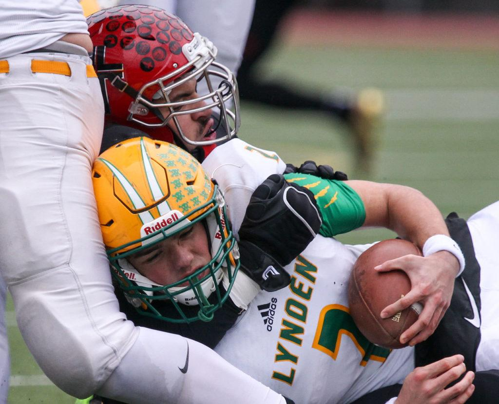 Archbishop Murphy's Abraham Lucas sacks Lynden's Jacob Hommes during a 2A state semifinal game Saturday afternoon at Everett Memorial Stadium. The Wildcats won 52-14. (Kevin Clark / The Herald)