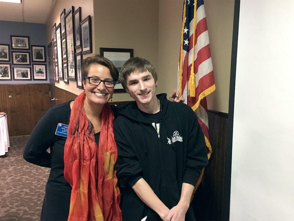 South Everett-Mukilteo Rotary Club President Cassie Franklin congratulates Micah Neptune on being named the club's October Student of the Month for ACES High School. (Contributed photo)