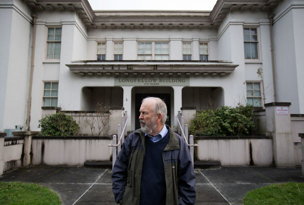 Jack O'Donnell looks down the street, where Longfellow Elementary School alum Henry Jackson lived, as he recalls his time attending the school in the 1950s on Tuesday in Everett. The school built in 1911 is scheduled for demolition to make way for a parking lot. (Andy Bronson / The Herald)