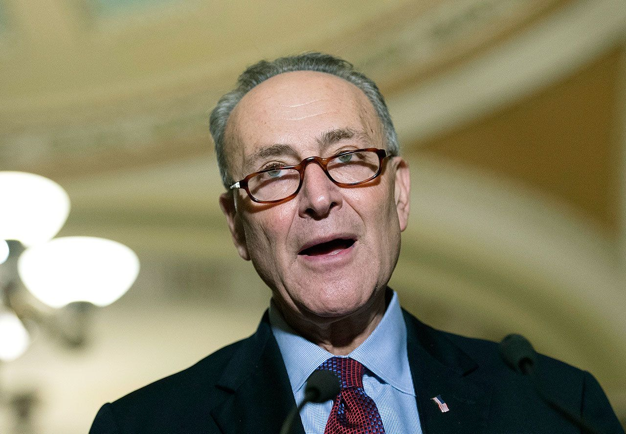 Sen. Charles Schumer, D-N.Y., speaks to the media after the Senate Policy Luncheon on Capitol Hill on Tuesday, Nov. 29, in Washington. (AP Photo/Molly Riley)