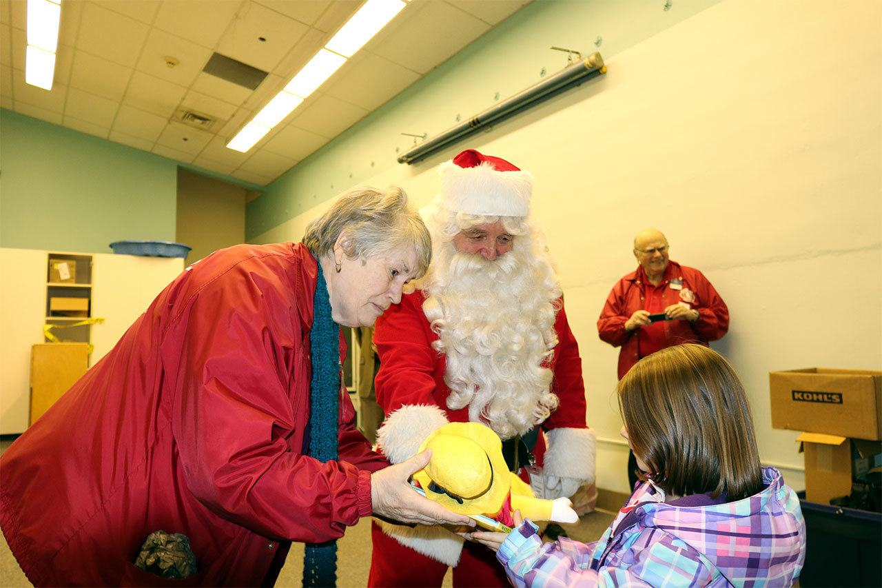 Santa (aka John Bruce) and his elf helper, Sonia Rahm, both from the Snohomish Tillicum Kiwanis, recently visited the Early Childhood Education and Assistance Program at Central Primary Center in Snohomish to deliver presents and other goodies. (Contributed photo)