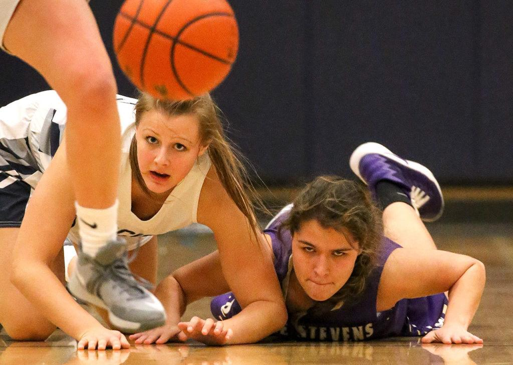 Glacier Peak's Abbie Juozapaitis (left) and Lake Stevens' Taylor Smith battle for a loose ball Wednesday night at Glacier Peak High School in Snohomish. (Kevin Clark / The Herald)
