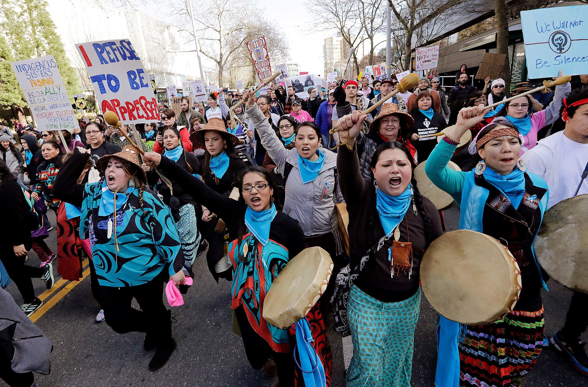 Native American women singing and drumming lead a women's march that brought tens of thousands Saturday in Seattle. (Elaine Thompson / Associated Pres)