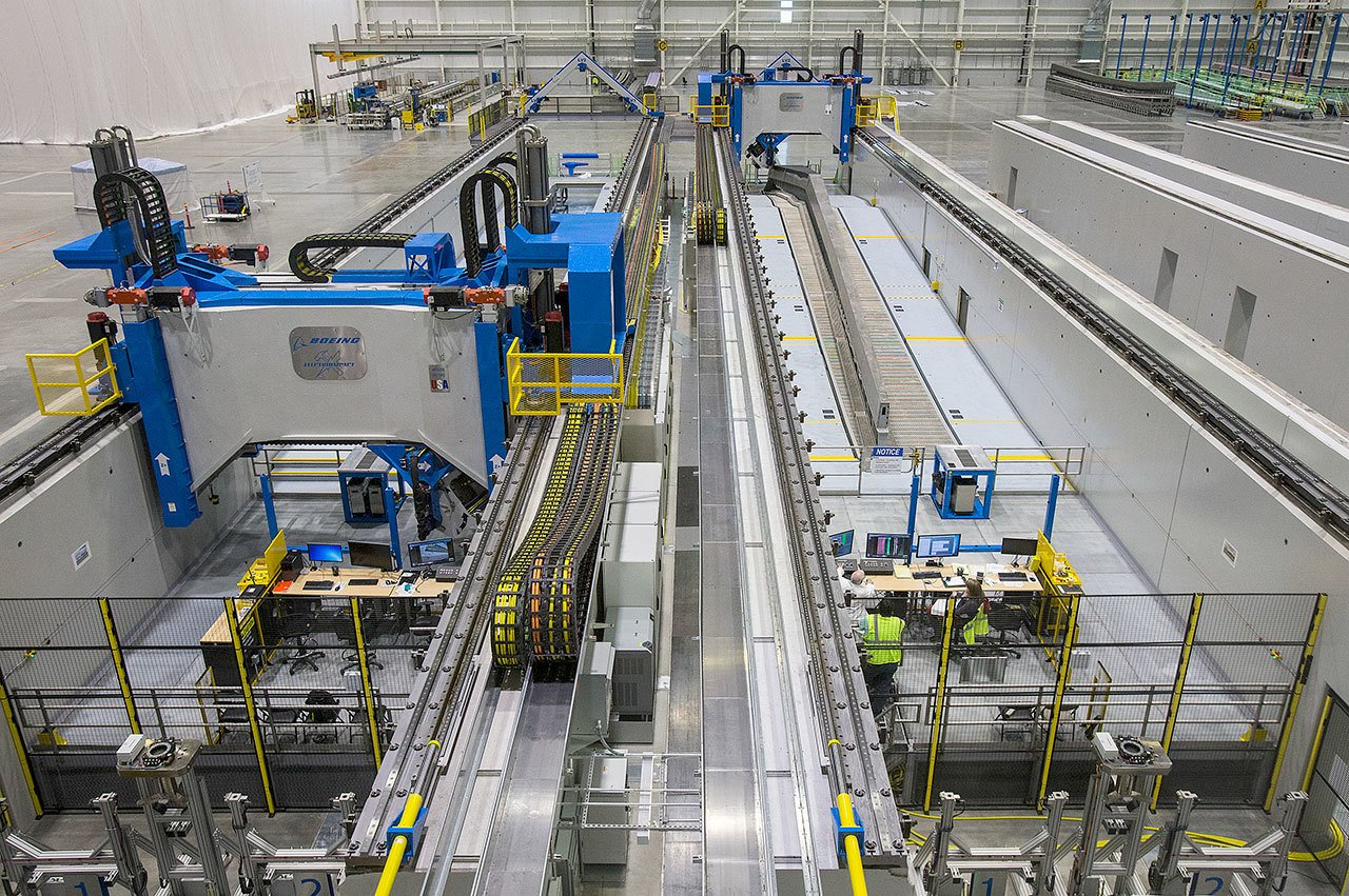 At Boeing's Composite Wing Center, engineers test Automated Fiber Placement machines, built by Electroimpact of Mukilteo, as the company moves closer to production of the 777X, in Everett in December. The machines lay carbon-fiber tape over the forms to create wing spars. (Andy Bronson / The Herald)