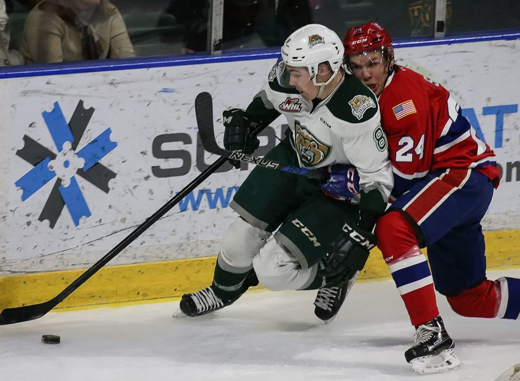 Everett's Patrick Bajkov holds off Spokane's Ty Smith during the Silvertips' 5-0 win over the Chiefs on Wednesday night at Xfinity Arena in Everett. (Kevin Clark / The Herald)