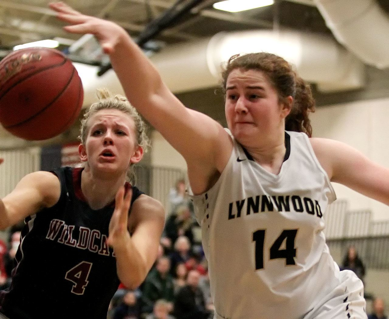 Mt. Spokane's Miahna Waters (left) and Lynnwood's Kelsey Rogers vie for a loose ball during a regional playoff game Feb. 25, 2017, at Bothell High School . Lynnwood won 57-46. (Kevin Clark / The Herald)