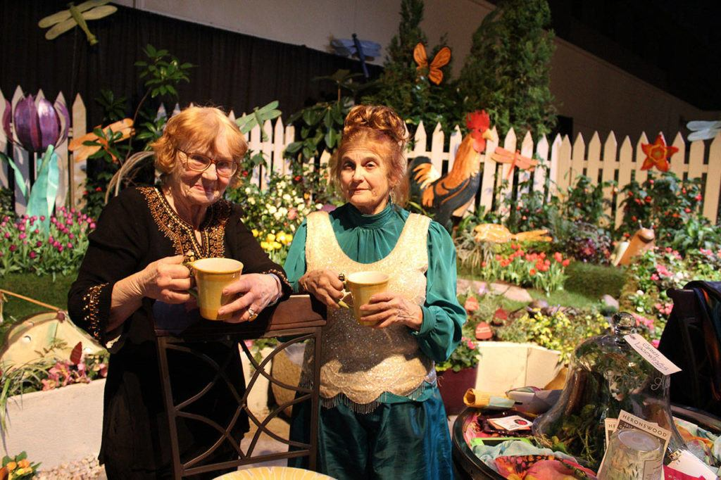 For more than 20 years, Vanca Lumsden of ALBE Rustics in Freeland (left) and Judith Jones of Fancy Fronds Nursery of Gold Bar have combined forces to create fanciful, fun displays at the annual Northwest Flower & Garden Show in Seattle. They've won Best of Show twice. (Patricia Guthrie / Whidbey News-Times)