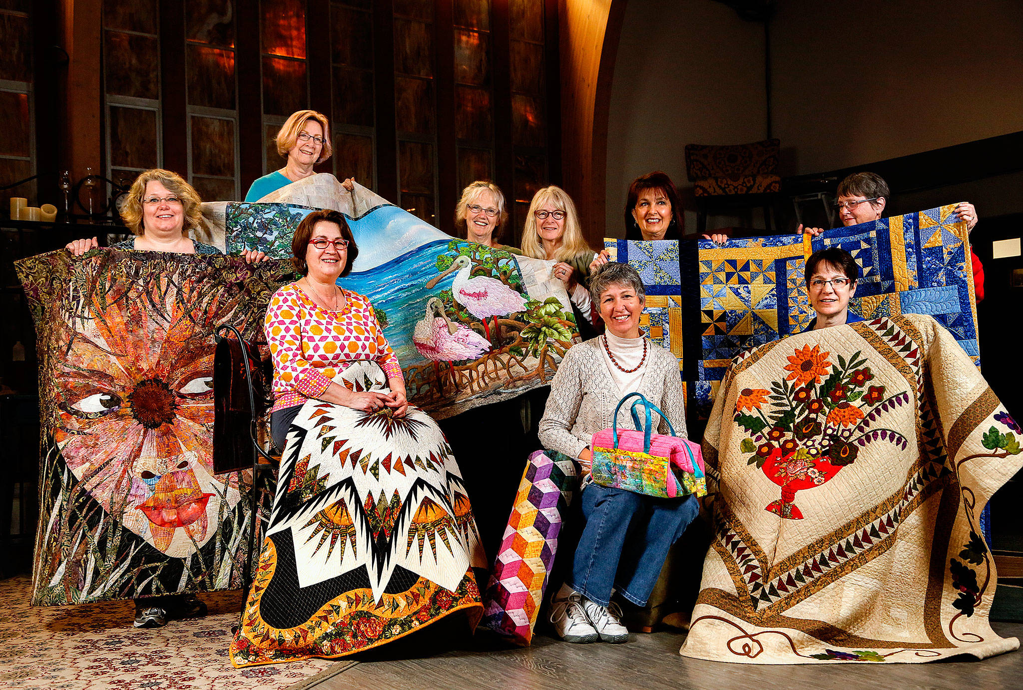 A first-ever Everett Quilt Show is scheduled for Friday and Saturday at Xfinity Arena conference center. It's presented by some extraordinarily talented quilters in the Marysville-based All in Stitches Quilt Guild. They met Tuesday at the Living Room Coffee House, bringing with them a few masterpieces. From left are Tammy Mohiswarnath, Grace Hawley, Becky Ray, Kathy McNeil, Cathryn Scott, Shawna Gould, Darlene McCourt, Vicki Hesseltine and Shirley Rock. (Dan Bates / The Herald)