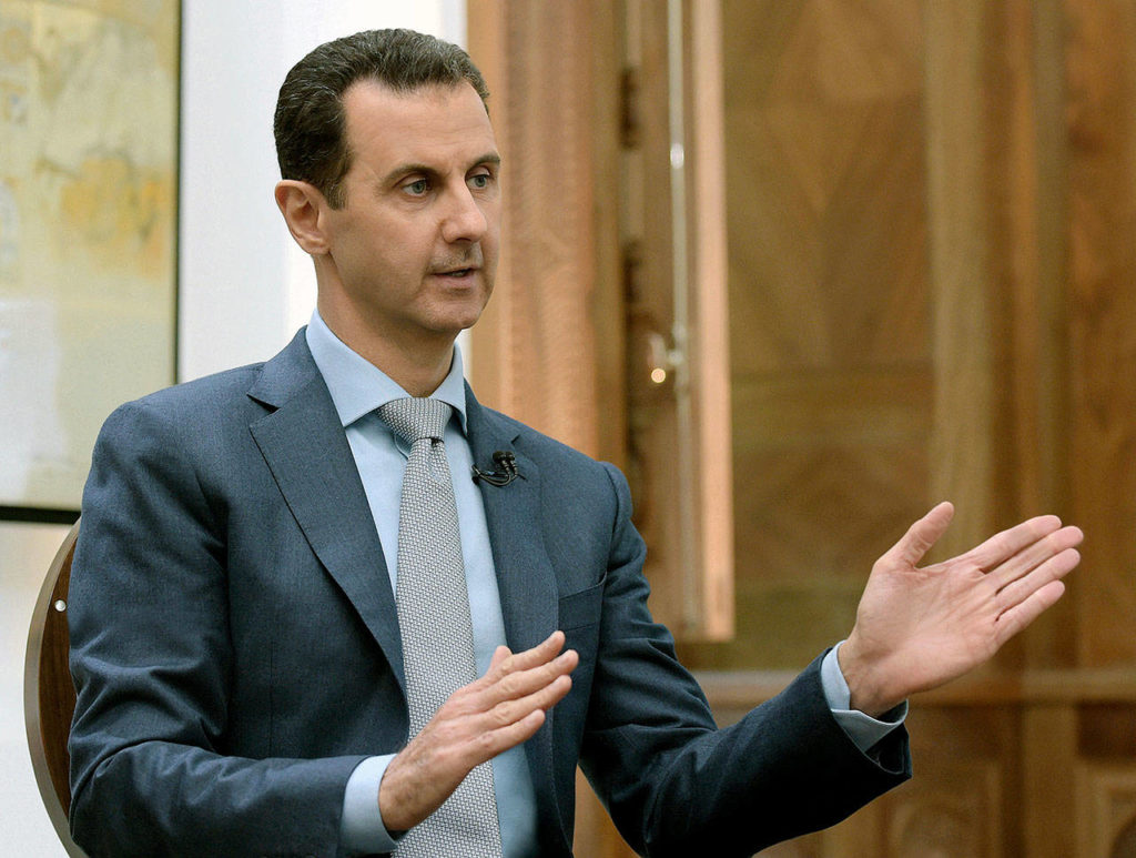 In this Feb. 10, 2017, photo released by the Syrian official news agency SANA, Syrian President Bashar Assad speaks during an interview with Yahoo News in Damascus, Syria. (SANA via AP, File)
