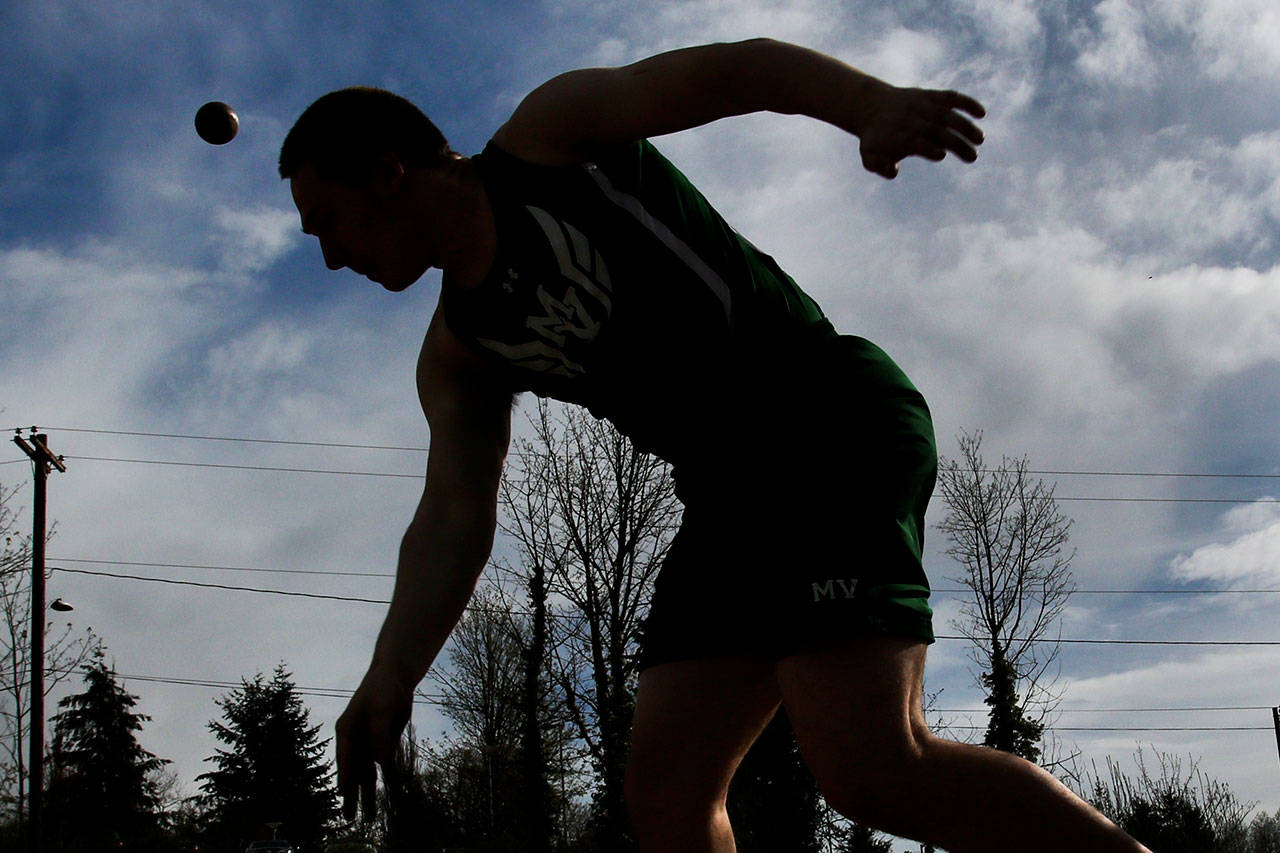 Mount Vernon senior Blayne Plessner lets the shot put fly during a Wesco 4A track meet with Cascade and Jackson on Thursday at Everett Memorial Stadium. Plessner's best throw of 41 feet, 2 inches was good enough for third, behind first-place Andrew Raymond of Cascade (42-5.75) and Mount Vernon's Daniel Carrillo (41-7.25). Plessner also finished sixth in the discus and ninth in the javelin on Thursday. (Kevin Clark / The Herald)