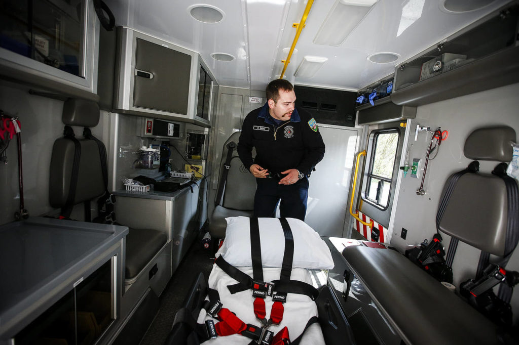 Darrington firefighter Drew Bono walks through the back of a new ambulance purchased with federal grant money on April 25. The new ambulance is the first in Darrington to have bariatric capabilities and four-wheel drive for better handling on the area's many dirt roads. (Ian Terry / The Herald)
