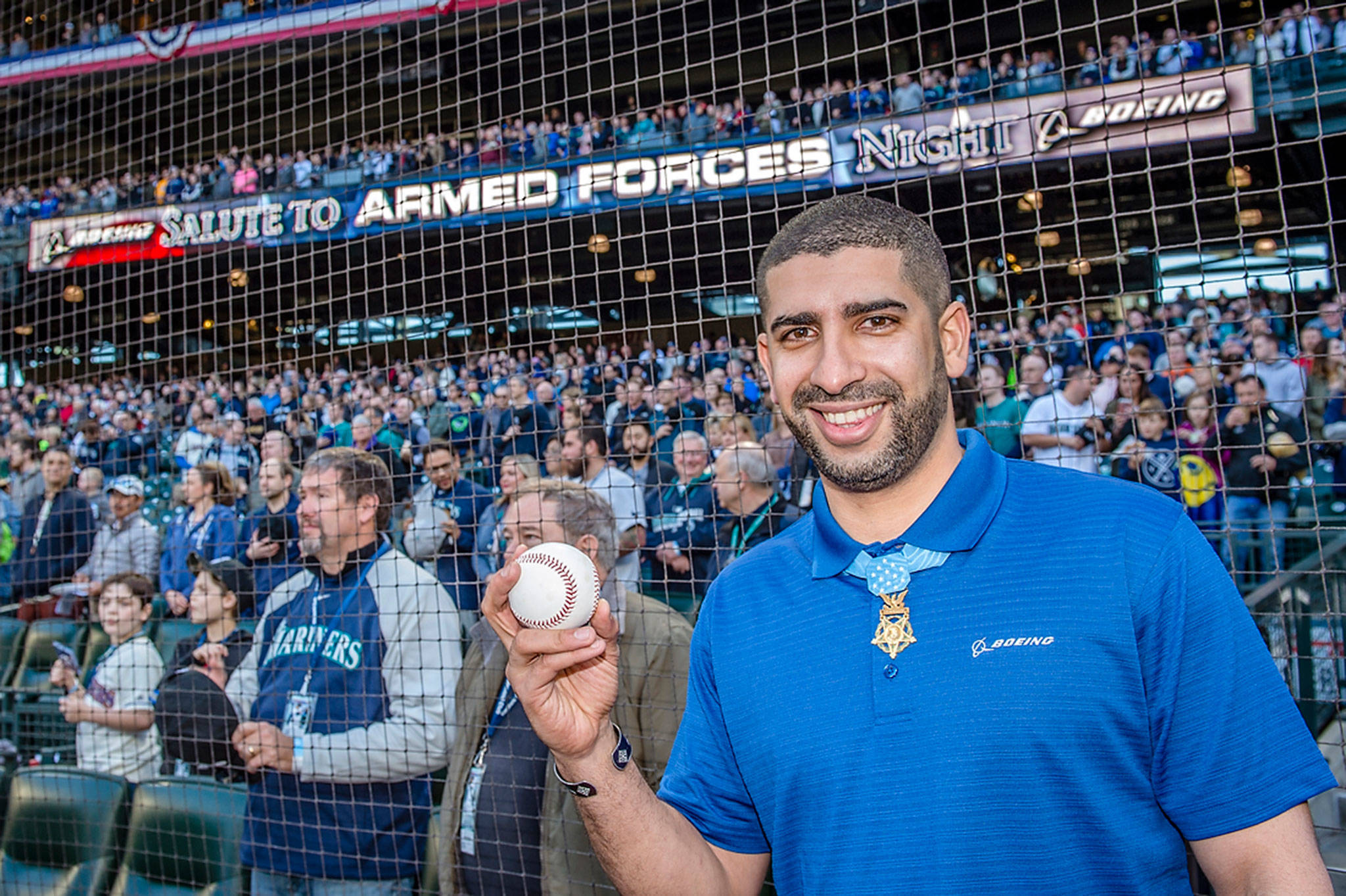 Flo Groberg, Boeing's director of veterans outreach and Medal of Honor recipient, prepares to throw out the ceremonial first pitch at the Mariners Salute to Armed Forces game, sponsored by Boeing.