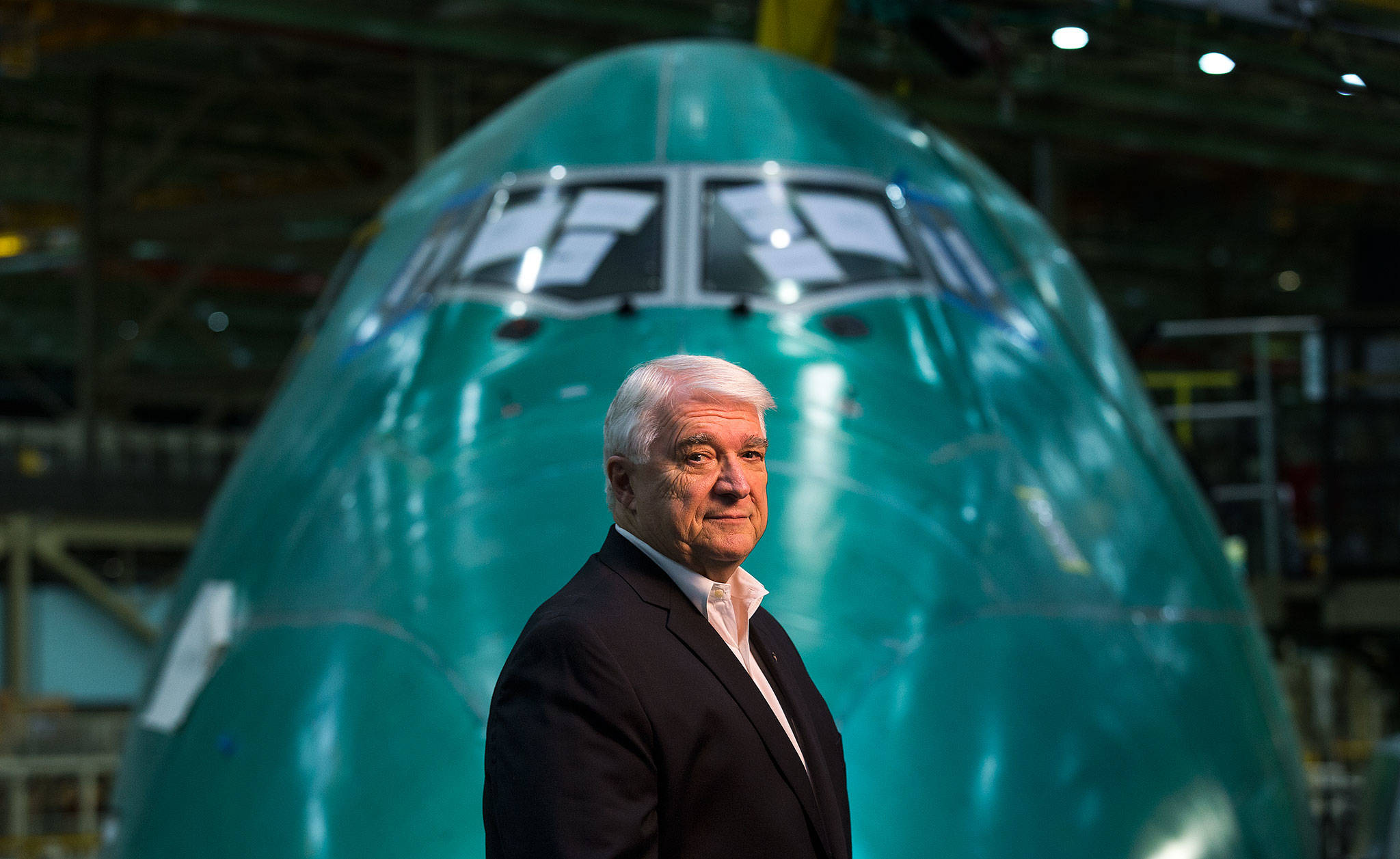 Engineer Bill Rietkerk in front of a Boeing 747-8 in the Everett factory on May 17. Rietkerk has been with the company since the Everett plant was built in 1967. (Andy Bronson / The Herald)
