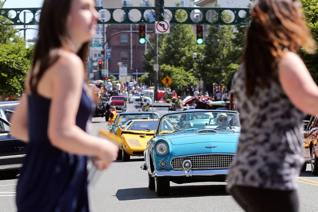 Pedestrians cross during the newly restored Cruzin Colby Sunday afternoon in downtown Everett on May 28, 2017. (Kevin Clark / The Herald)