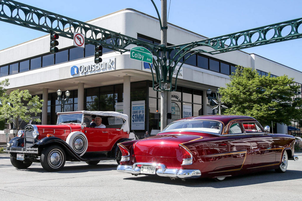 Classic cars make the loop during the newly restored Cruzin Colby Sunday afternoon in downtown Everett on May 28, 2017. (Kevin Clark / The Herald)