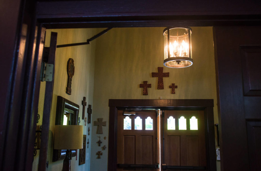 The entryway of the former Mukilteo Presbyterian Church is adorned with the Yeadons' collection of crosses and and old-style lanterns. (Daniella Beccaria / For The Herald)