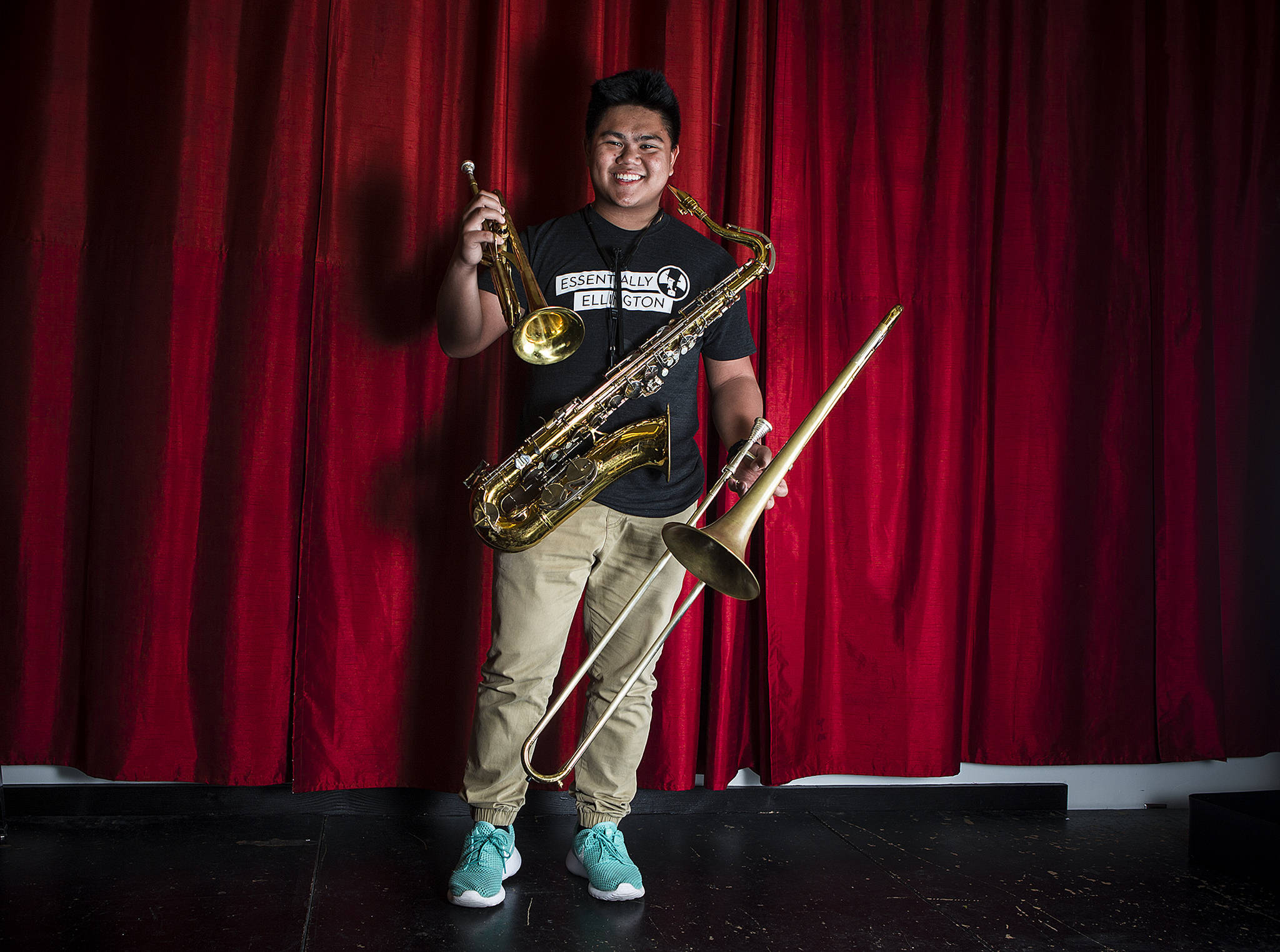 Mountlake Terrace High School student Andrew Sumabat plays the trombone, saxophone and trumpet and is headed to the University of Washington this fall. (Ian Terry / The Herald)