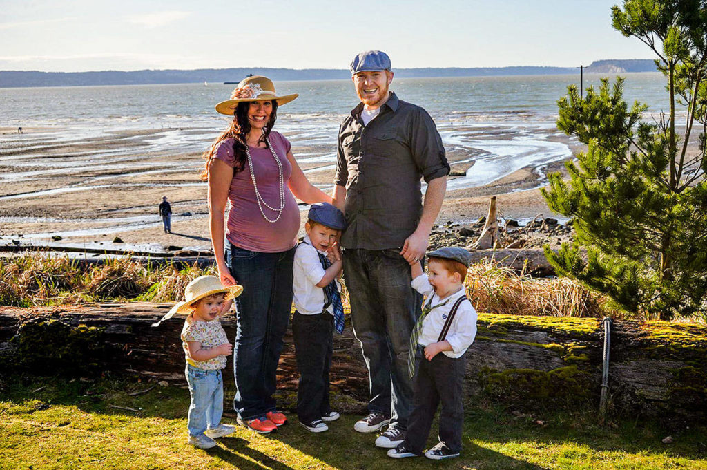 A recent family photo taken at a Snohomish County beachfront park shows Amy, Alex, and their children Seirsha, Willem and Atley. Amy is pregnant with Elayda in the photo. (Photo courtesy of Alex Clawson)