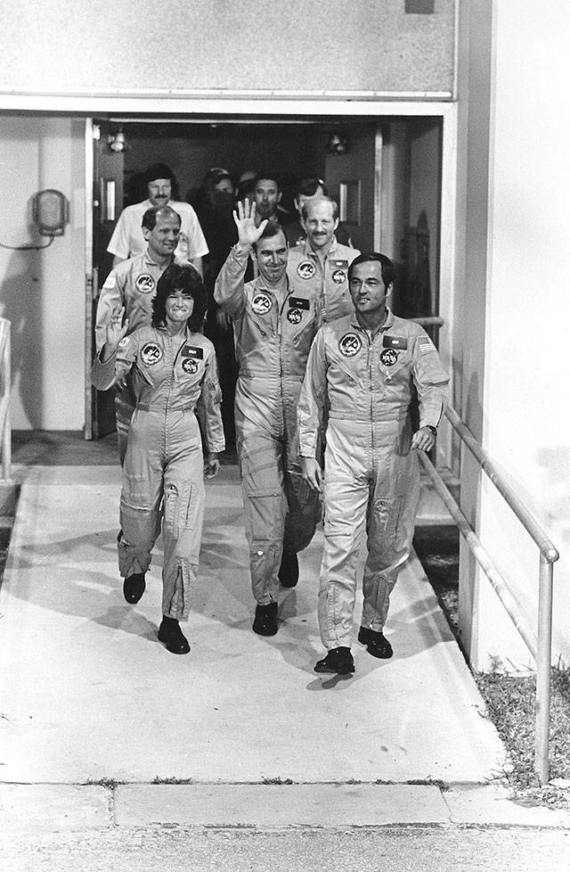 The crew of space shuttle Challenger, including first American woman in space Sally Ride, leaves for boarding at Kennedy Space Center in Florida on June 18, 1983. (Associated Press archive)