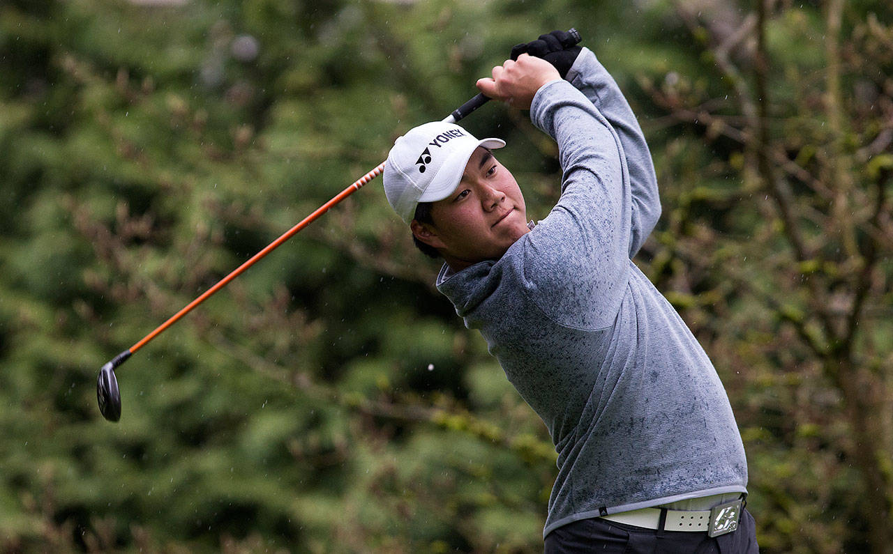 Kamiak High School's Alvin Kwak chips onto the green during the Dolan Invitational at Everett Golf & Country Club on April 10, in Everett. He's vying to reach match play at the U.S. Junior Amateur Golf Tournament. (Andy Bronson / The Herald)