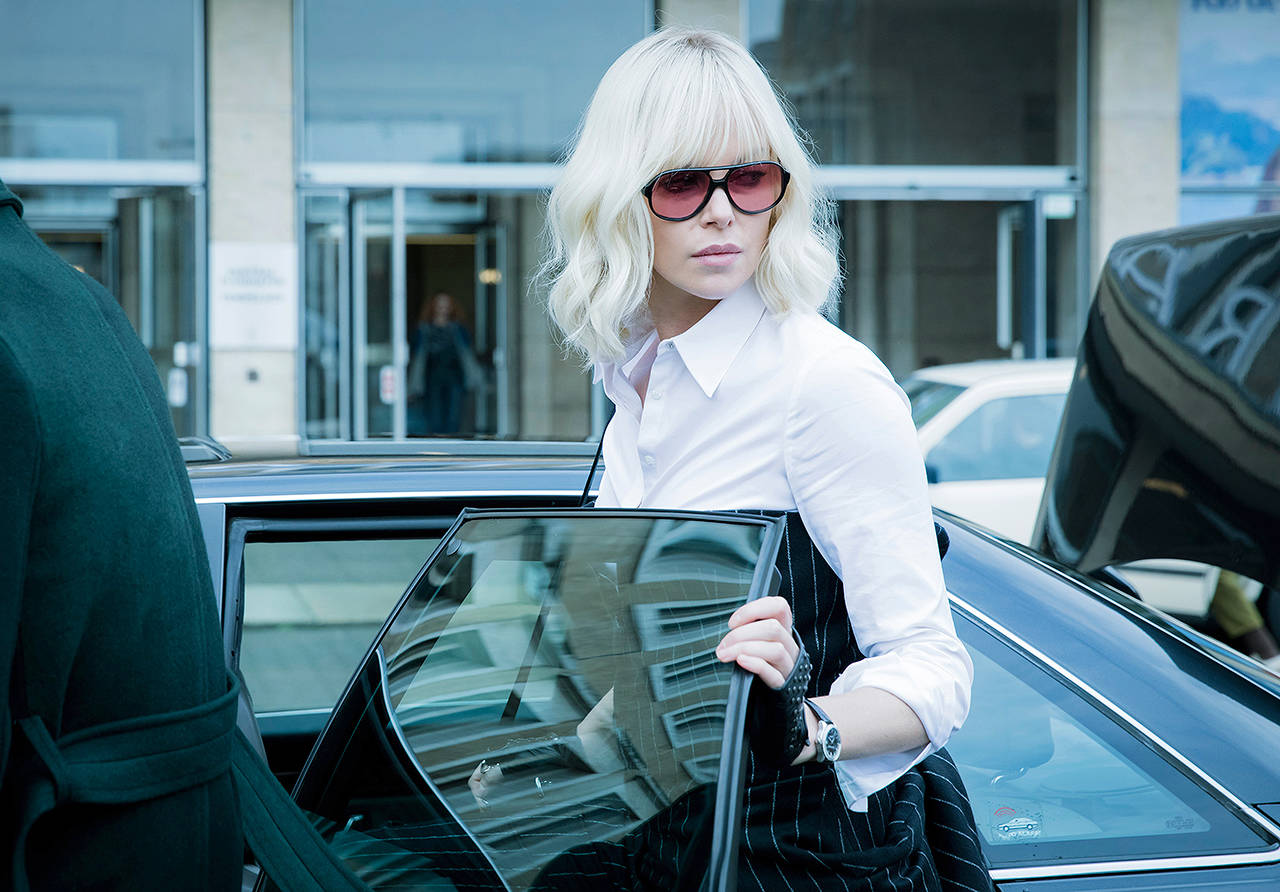 """Charlize Theron plays an undercover MI6 agent who is sent to Berlin during the Cold War to investigate the murder of a fellow agent and recover a missing list of double agents in """"Atomic Blonde."""" (Jonathan Prime/Focus Features via AP)"""