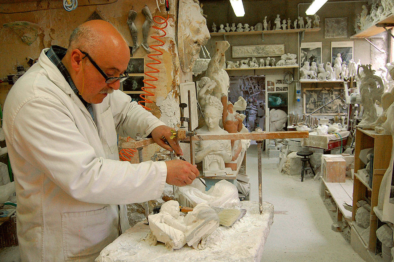 Artisans like this alabaster sculptor in Volterra, Italy, keep the local craft alive — and provide meaningful souvenirs for travelers. Rick Steves' Europe