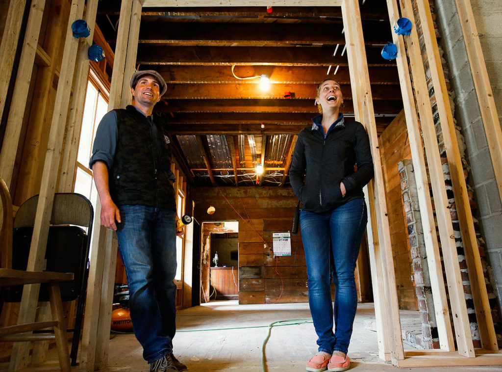 With light hearts and easy smiles, Blair and Kathy Corson appear to handle the many difficulties of reconstructing a 118-year-old hotel. (Dan Bates / The Herald)