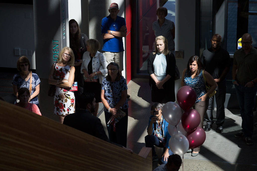 Guests listen as they begin a tour during an open house and ribbon-cutting ceremony at the Washington State University Everett building on Tuesday. (Andy Bronson / The Herald)