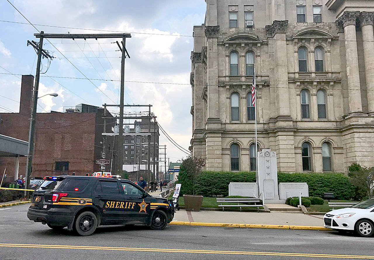 The scene of the ambush-style shooting of Jefferson County Judge Joseph Bruzzese Jr. as he walked toward the Jefferson County Courthouse in Steubenville, Ohio. Bruzzese was wounded and the suspect was killed. (WTOV-TV via AP)