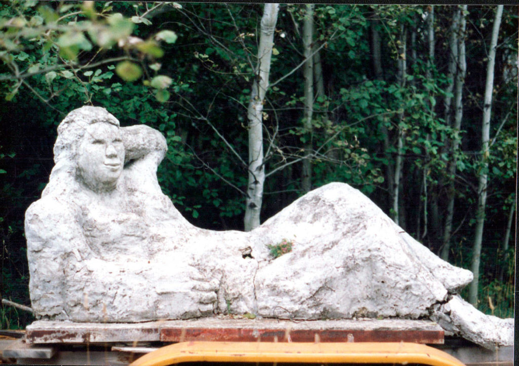"""Artist Kay Henkel made this reclining nude, dubbed the """"Virgin of Perrinville,"""" to attract attraction to her studio near the Edmonds/Lynnwood border in the 1970s. Leila Pearsall bought it and shipped it to Arizona, where it shares the grounds of a bed-and-breakfast with a mermaid sculpture made by Henkel. (Submitted photo)"""