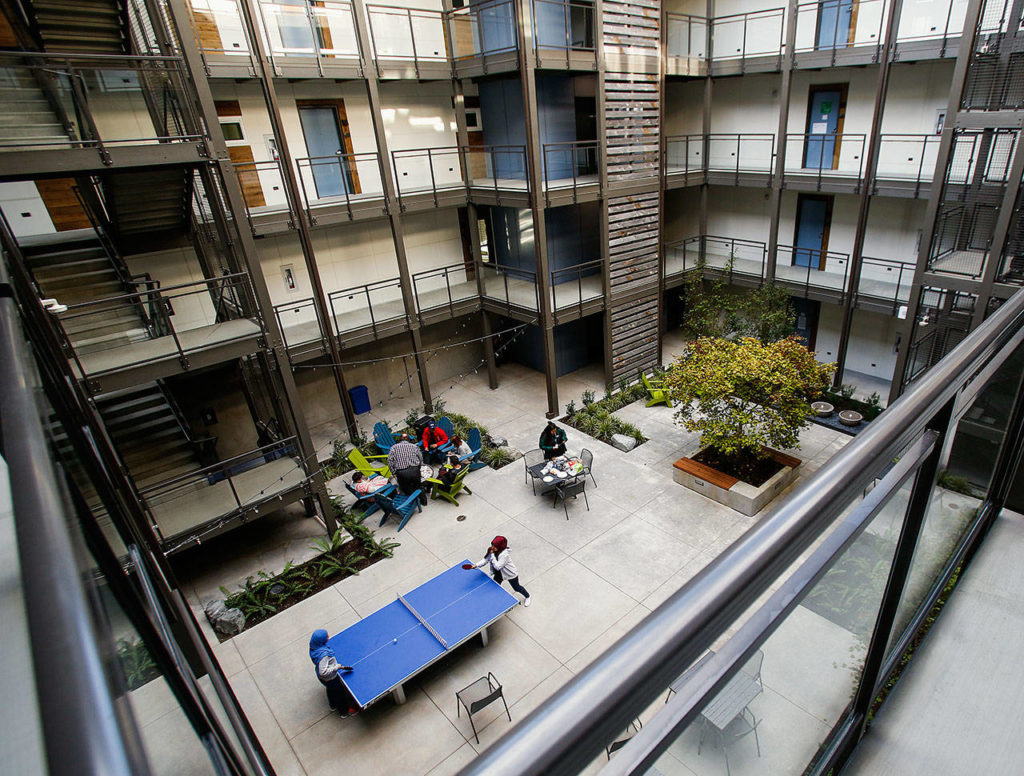 The new Cedar Hall, a residence hall at EvCC, has four-bedroom and three-bedroom suites and studio apartments all opening onto a secure open-air courtyard. Ammenities include a gas fire pit, ping pong table, TV lounge and laundry facilities. Up to 132 people can have their own bedrooms. (Dan Bates / The Herald)