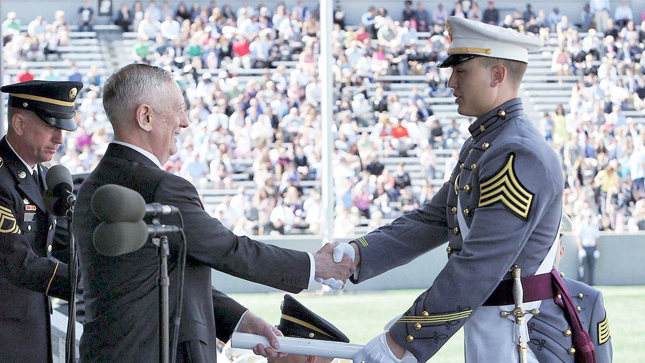 2nd Lt. Quinn Carlson shakes the hand of Defense Secretary James Mattis at the U.S. Military Academy graduation ceremony on May 27, 2017. (Contributed photo)
