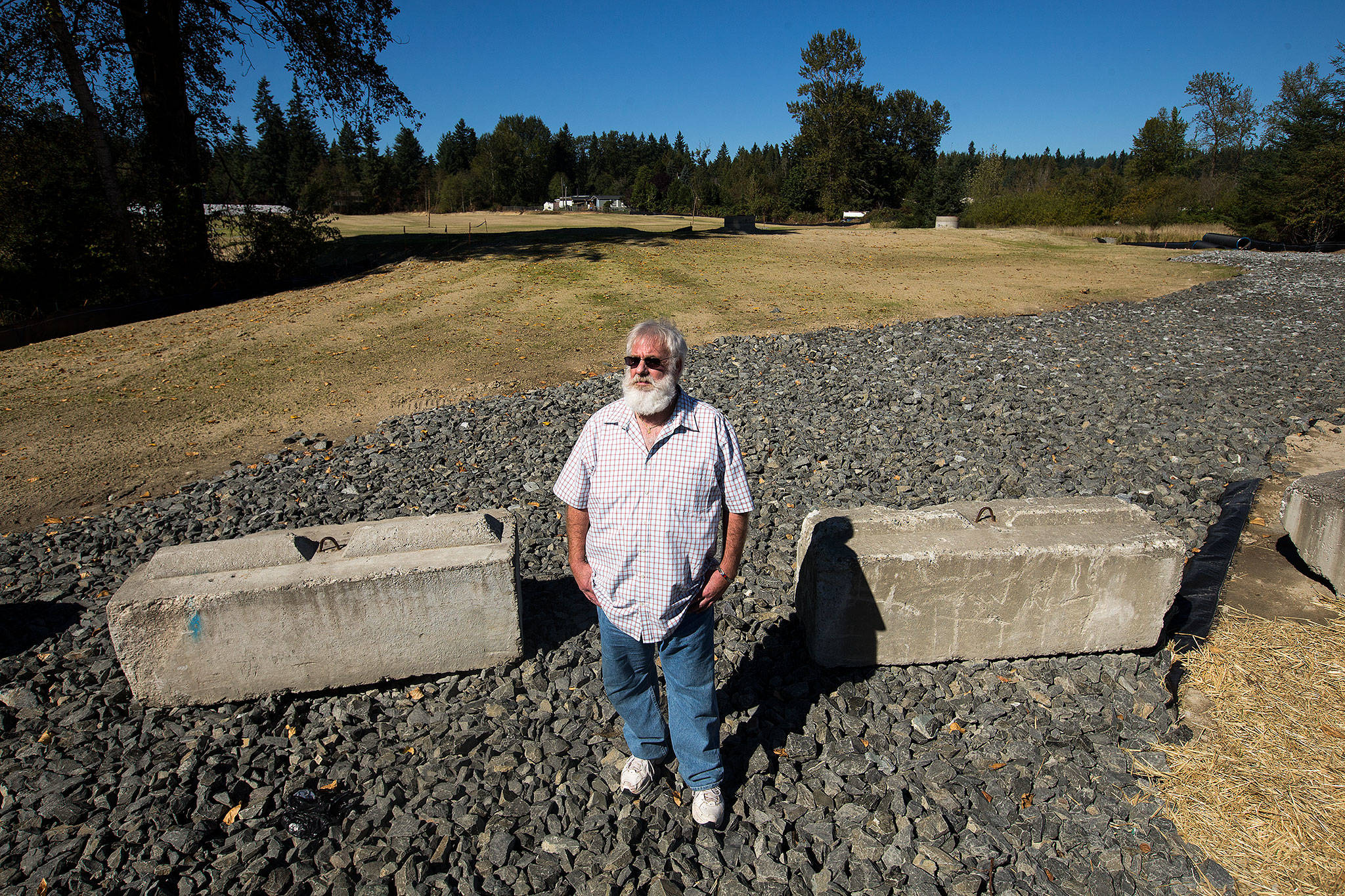 Jeff Salisbury stands in front of an 11-acre site that heavy equipment operators had cleared, without permits, along Broadway Avenue in Maltby, on Wednesday. Shipley and others blew the whistle in a case involving truck maker OSW Equipment & Repair that has turned into the most glaring code-enforcement case in recent memory in Snohomish County. (Andy Bronson / The Herald)
