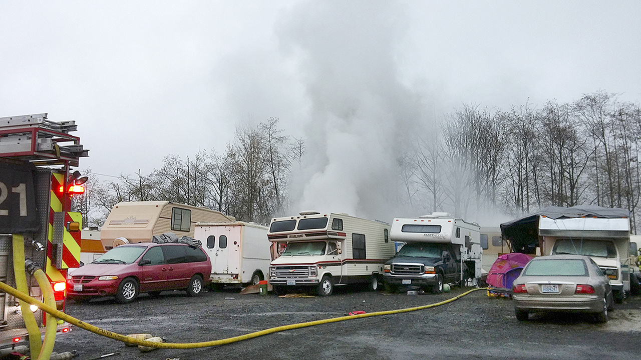 Officials investigated this makeshift trailer park on an industrial lot after a camper caught fire near Lynnwood last year. (Rikki King / The Herald)