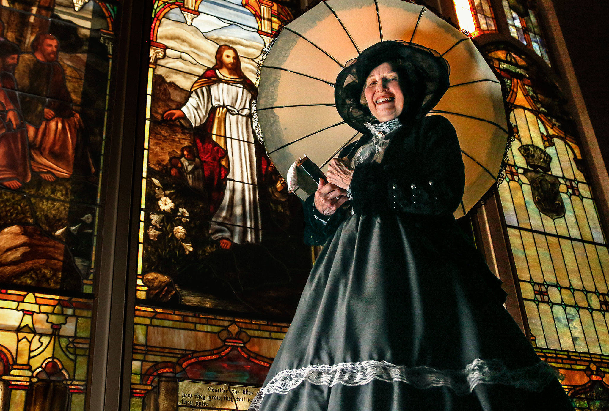 """Carolyn Hetherwick Goza, a member of Everett's First Presbyterian Church, models a period dress at the church that would have been appropriate Sunday garb in 1892. Goza will perform an historical skit at Sunday's """"Celebrating God's Love"""" concert, an event at First Presbyterian marking the 125th anniversaries of five Everett churches. (Dan Bates / The Herald)"""