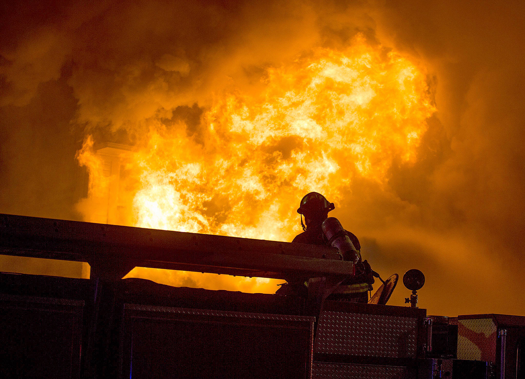 Flames burst out from the front face of Everett Office Furniture on Broadway on Sept. 25 in Everett. The fire caused damage estimated at $1.5 million. (Andy Bronson / The Herald)