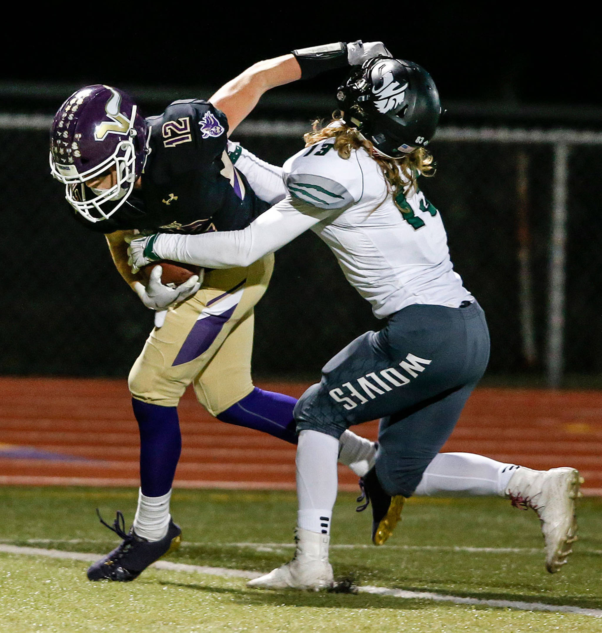 Lake Stevens' Austin Murren (left) stiff-arms Jackson's Chris Grayson during a game at Lake Stevens High School on Sept. 29. (Ian Terry / The Herald)