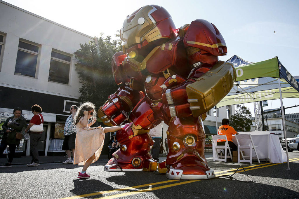Mikaelin Hann, 6, of Everett, gives a gigantic Ironman toy a playful kick during the grand opening of Funko in downtown Everett. (File photo)