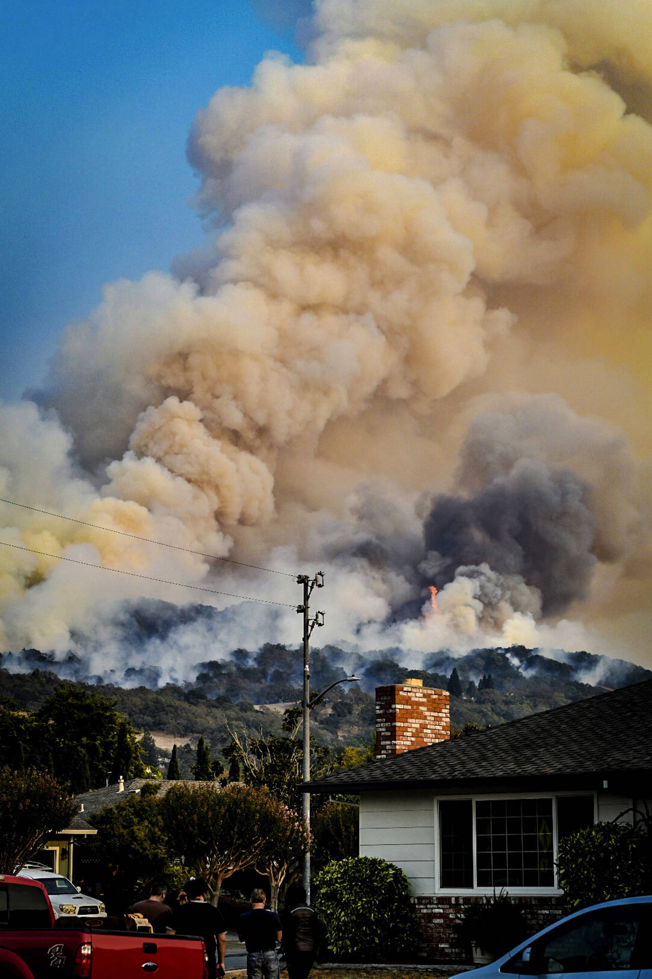 In this Oct. 11 photo, smoke rises from fires in Santa Rosa, California. (Derek Anderson via AP)