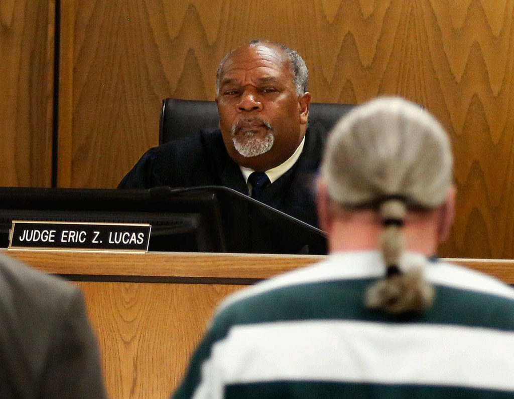 Snohomish County Superior Court Judge Eric Lucas studies convicted bank robber Christian Franzwa as Franswa makes a statement before sentencing Wednesday. (Dan Bates / The Herald)