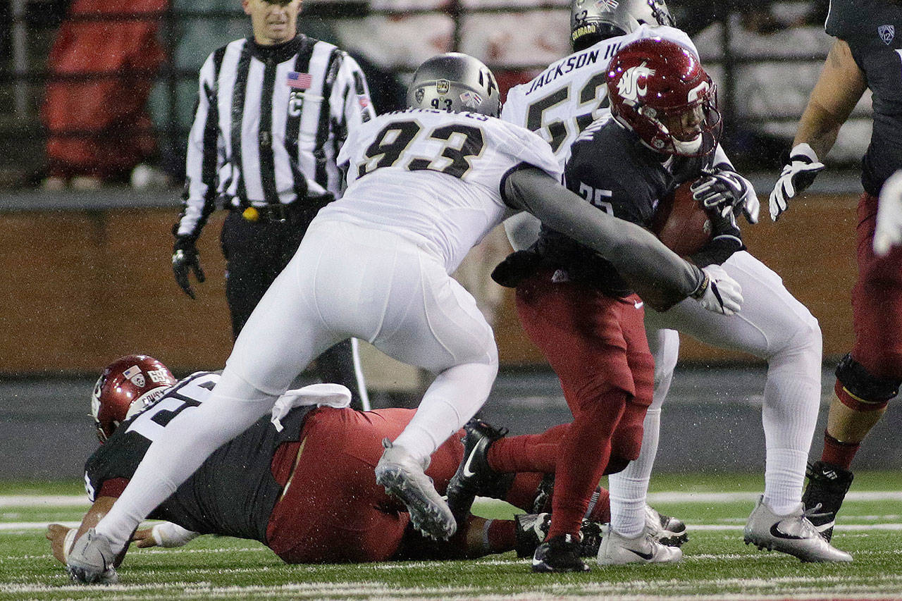 Colorado linebacker Michael Mathewes (93) tackles Washington State running back Jamal Morrow (25) during the first half of a game Saturday in Pullman. (AP Photo/Young Kwak)