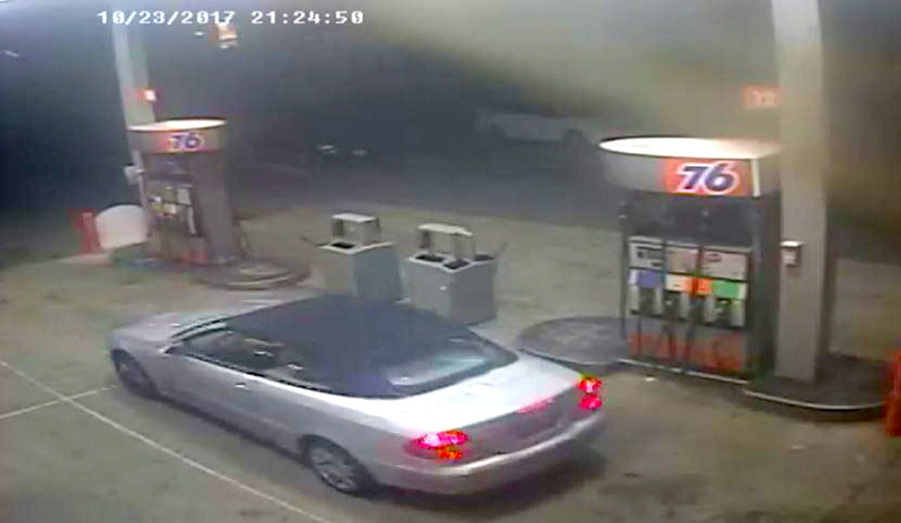 Detectives believe the same armed woman robbed two gas stations within minutes of each other Monday night on Bothell Everett Highway. She fled in a silver convertible car with a soft black top. (Snohomish County Sheriff's Office)